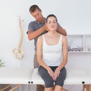 lady receiving neck treatment